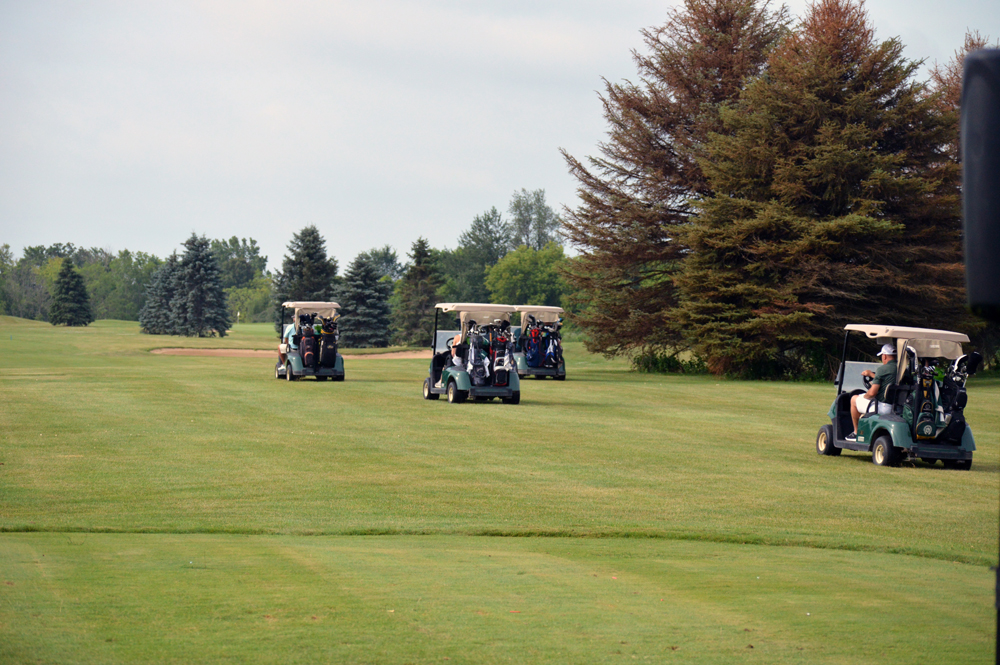 Golf Carts Driving Out To Play