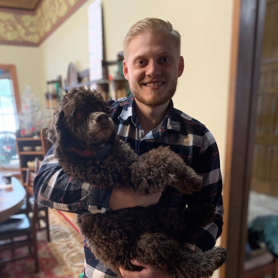 Photo of Isaac Slajus and his dog